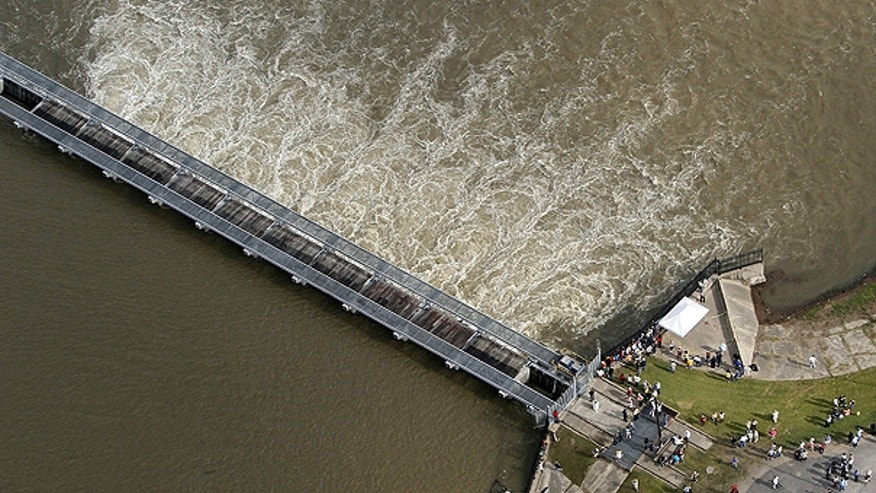 May 9: People gather to look at opened bays on the Bonnet Carre Spillway in Norco, La.  The spillway, which the Army Corps of Engineers built about 30 miles upriver from New Orleans in response to the great flood of 1927, last opened during the spring 2008.