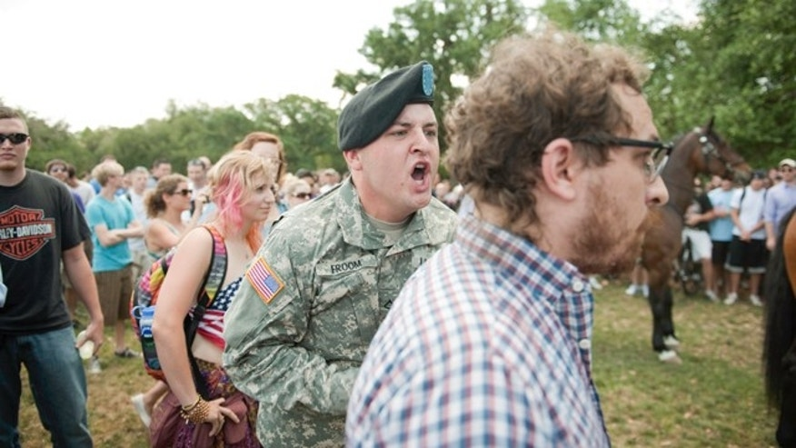 May 11, 2011: Member of the army yells at Benjamin Haas, an LSU student who planned a flag-burning protest on campus.