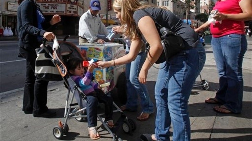 May 11: Women buy ice cream from a sidewalk vendor in downtown Los Angeles. According to Census Bureau figures the population of people of Mexican descent in California grew by 6 percent in the last decade.