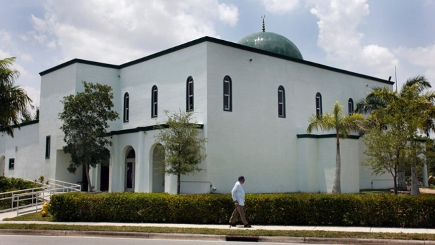 May 14: A pedestrian walks past the Jamat Al-Mummineen Mosque in Margate, Fla., where imam Izhar Khan has been charged with providing about $50,000 in financial support to the Pakistani Taliban.