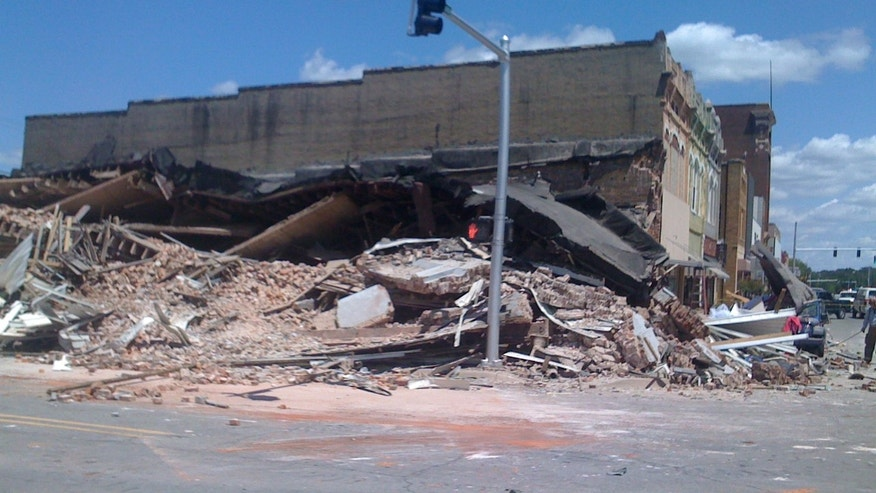 May 16: A building that housed a beauty parlor in downtown Morrilton, Ark. collapsed killing a young girl and injuring at least five other people. According to police, rescue teams are searching the wreckage for possible survivors but they think most people escaped.