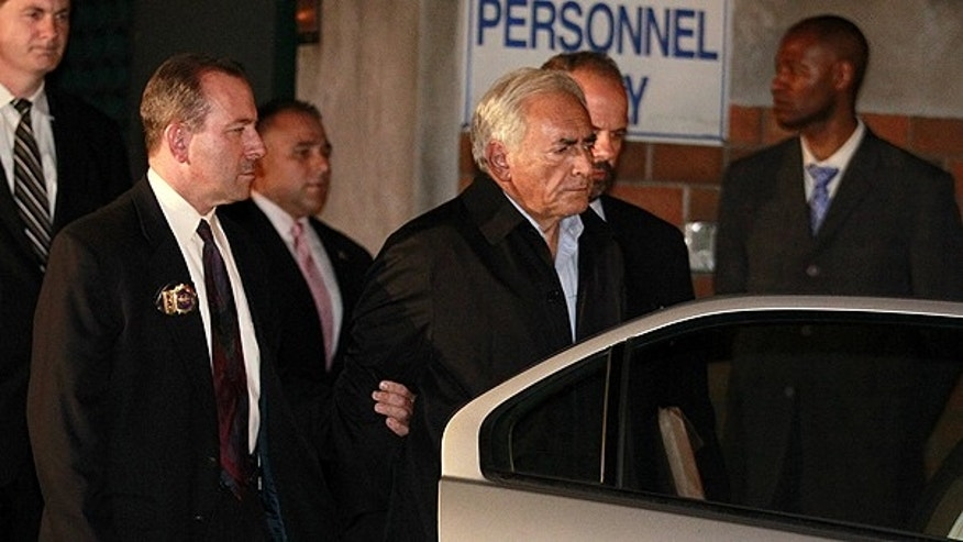 May 16: Dominique Strauss-Kahn, head of the International Monetary Fund, is taken away from a police station in New York where he was being held.