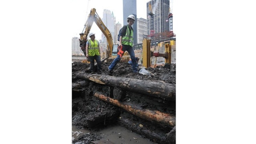 "Archaeologists discover an underground grid at Ground Zero, built like log cabins, dating back to the 1700s. Colonialists filled the grid's boxes, called ""cribs,"" with dirt and trash to create land."