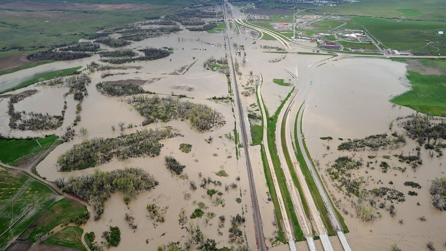 May 22: Flood water from the Little Bighorn River covers Interstate 90 near Crow Agency, Mont., in this aerial view on Sunday, May 22, 2011. (AP/The Billings Gazette)