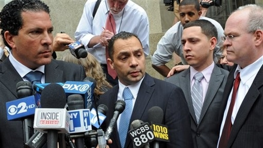 May 26: Police officer Ken Moreno, middle with co-defendant Franklin Mata, right, speak to the media outside Manhattan criminal court in New York.
