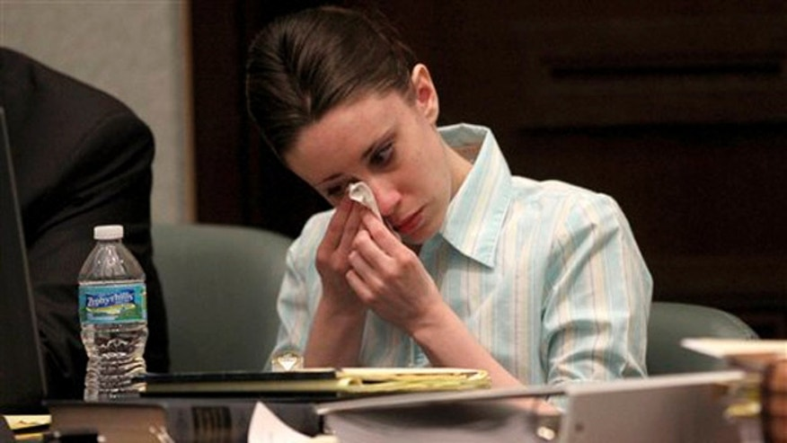 May 26, 2011: Casey Anthony reacts during her trial at the Orange County Courthouse in Orlando (AP).