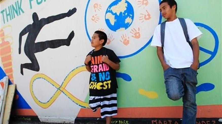 May 10: Van Buren Elementary school seventh grade students take a break at school in Stockton, California.