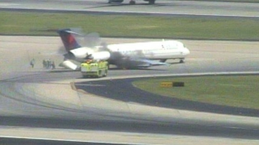 May 28: Fire crews work to douse the plane after a hard landing at Atlanta's Hartsfield-Jackson International Airport.