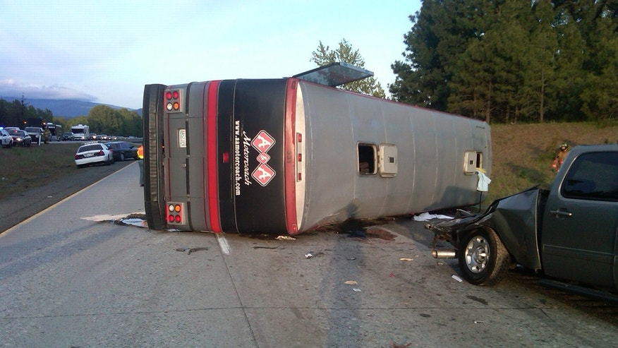 May 28: In this image provided by the Washington State Patrol a tour bus carrying fans home from a soccer game lies on it's side after crashing into a disabled pickup on the shoulder of Interstate 90 in central Washington Saturday evening, triggering a three-vehicle crash that killed two people and injured up to 15 others, authorities said. The bus carrying about 15 passengers was en route from Seattle, where the soccer game was held, to Moses Lake in Grant County. (AP/Washington State Patrol)