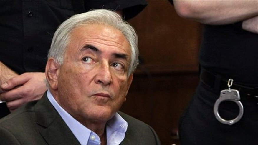 Dominique Strauss-Kahn hired all-male cleaning staff to clean up after him at his New York townhouse (AP).