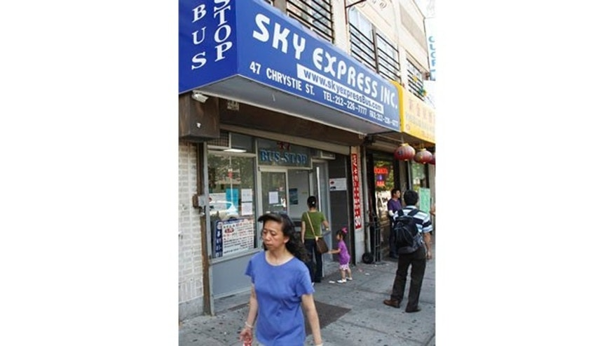 May 31: Pedestrians pass a ticket location for Sky Express's bus service in New York.