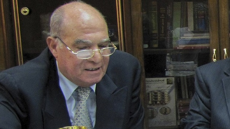 In this photo taken Thursday, July 15, 2010, Mahmoud Abdel Salam Omar, Chairman of the Egyptian state-run salt production company El-Mex Salines Co., and former chairman of Egypt's Bank of Alexandria, is seen at the company's headquarters in Alexandria, Egypt.