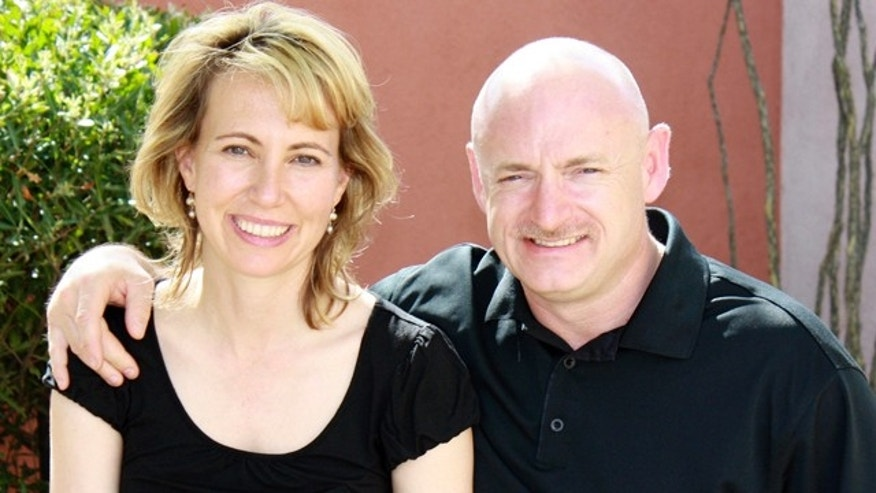 FILE: Rep. Gabrielle Giffords with her husband, NASA astronaut Mark Kelly, before the January shooting.