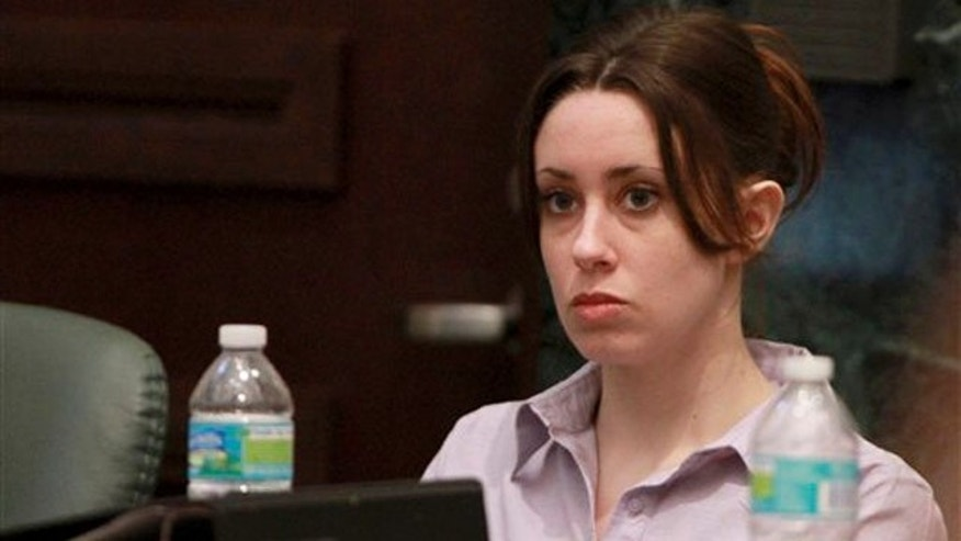 June 6, 2011: Casey Anthony listens to testimony during her trial at the Orange County Courthouse in Orlando.