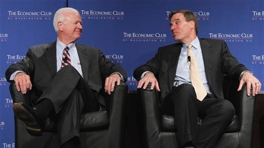 "June 8: Sen. Saxby Chambliss, R-Ga. and Sen. Mark Warner, D-Va., members of ""The Gang of Six"" participate in a discussion on the federal budget, deficit reduction and the debt ceiling during a luncheon of the Economic Club in Washington, D.C."