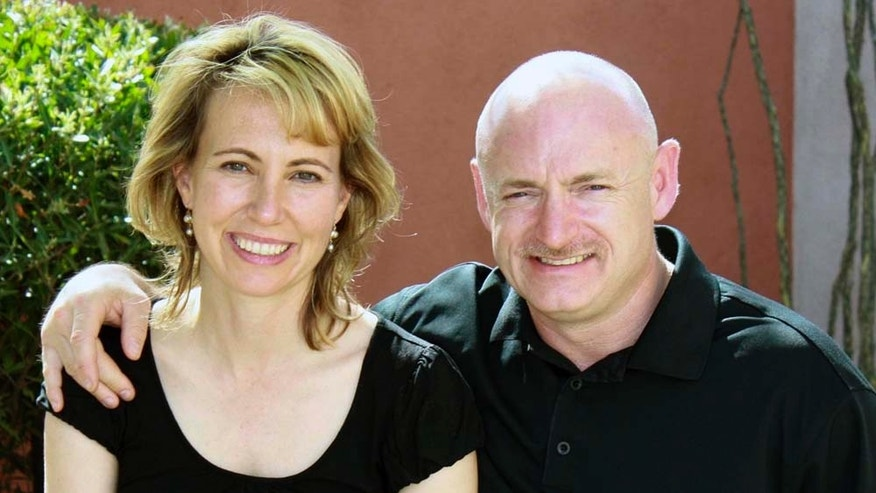 In this undated photo, Rep. Gabrielle Giffords is seen with her husband Mark Kelly. Early news reports indicated that the injured congresswoman was making steady progress, but an interview with an aide describes a daily struggle.