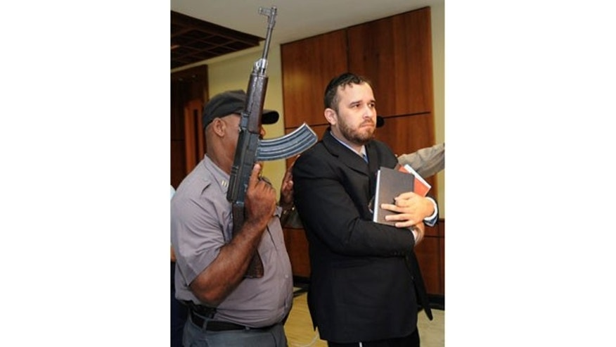 April 2010: Jorge Torres is escorted to the Supreme Court for a hearing regarding a U.S. request for his extradition related to human trafficking charges in Santo Domingo.