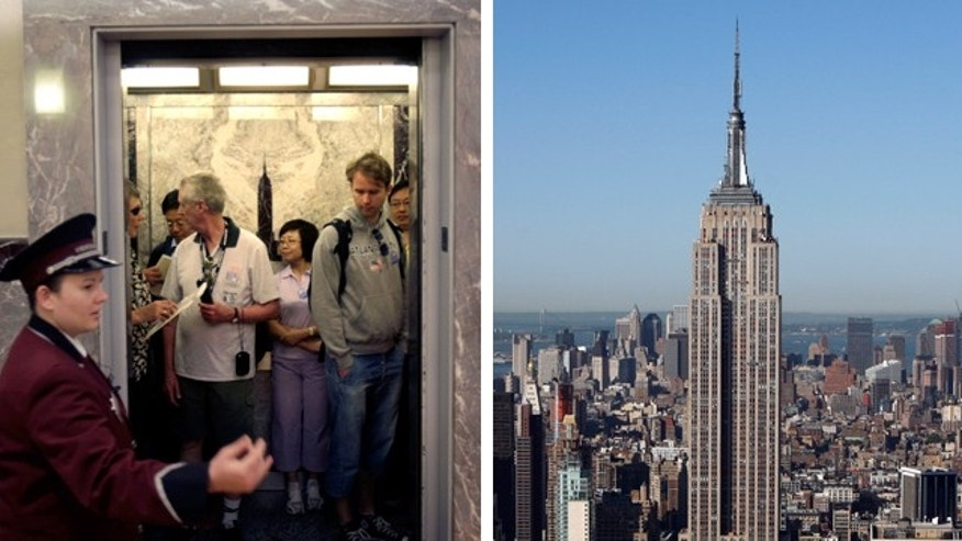 June 16: Tourists pack into an elevator at the Empire State Building in New York, which is set to install faster elevators.