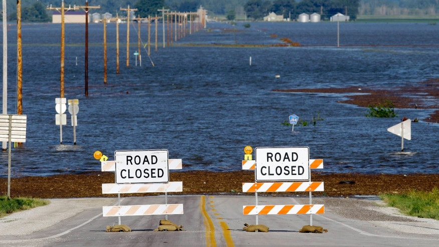 June 15: Flood waters from the nearby Missouri River cover a county highway in Hamburg, Iowa. The water level continues to rise and officials say that it should crest sometime later this week.