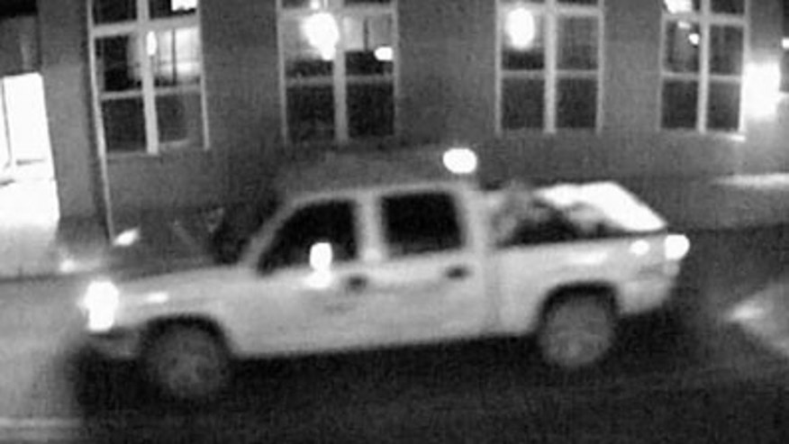 Police are looking for the owner of this white pickup truck that may have a connection in the disappearance of Indiana University student Lauren Spierer. Police believe the vehicle, captured here in a surveillance video image on June 3, is a mid-2000s shortbed four-door Chevrolet Silverado or Colorado. (Bloomington Police Department)