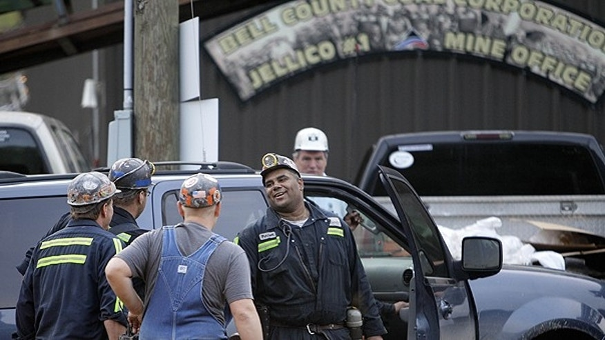 June 20: Pernell Witherspoon is congratulated after being rescued from within the Jellico Mine No 1. in Middlesboro, Ky.