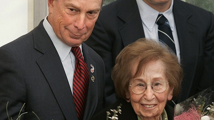 In this Feb. 1, 2007 file photo, New York City Mayor Michael Bloomberg, left, looks on as his ninety-eight year old mother Charlotte, right, holds flowers at a cornerstone ceremony for the Magen David Adom's William H. Bloomberg Jerusalem Station, named after his late father in Jerusalem.