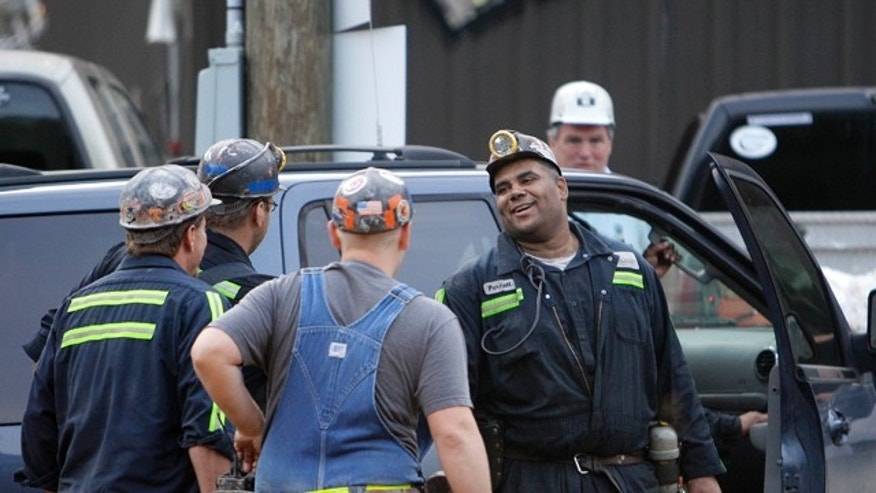 June 20: Pernell Witherspoon is congratulated after being rescued from within the Jellico Mine No 1. in Middlesboro, Ky. Three mine maintenance workers were freed and appeared to be in good health Monday after being trapped for 14 hours in the flooded southeastern Kentucky mine. (AP)