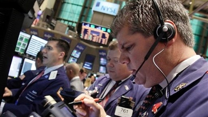 June 14: Traders work on the floor of the New York Stock Exchange.