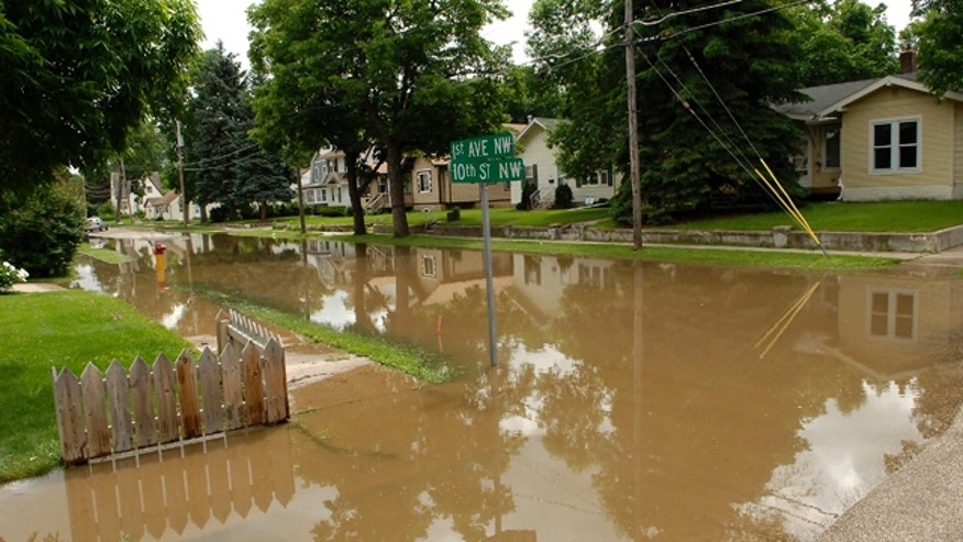 June 22: Water fills the streets in the Oak Park neighborhood of  Minot, N.D.