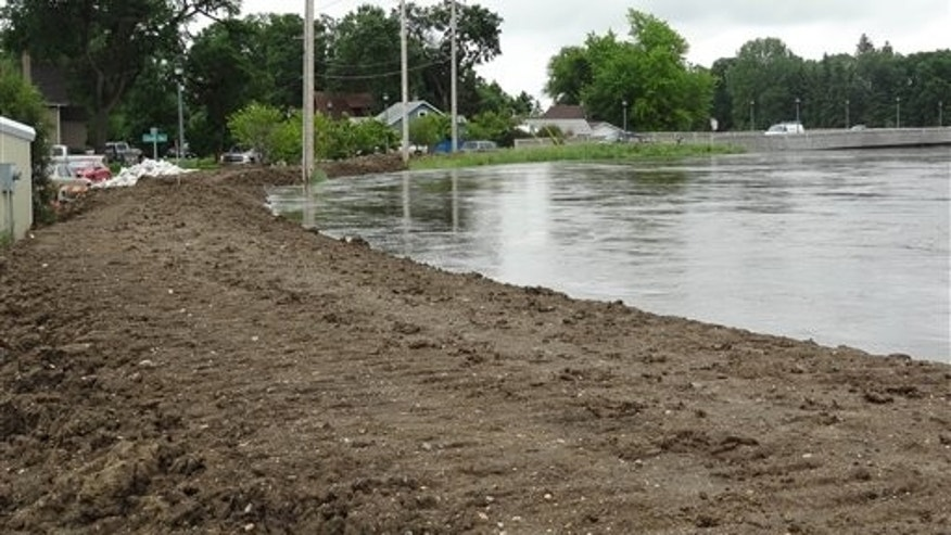 June 21: The rising Souris River passes through Minot, N.D. About 11,000 Minot residents are being ordered to leave their homes even earlier than expected this week as the Souris River gets closer to swamping the North Dakota city with the worst flooding in four decades, officials said Tuesday.