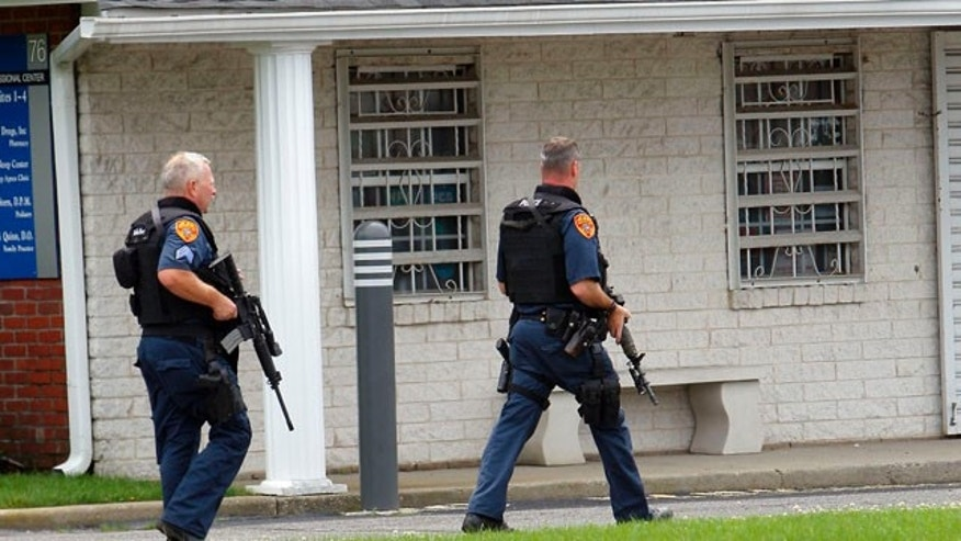 June 19:   This is a picture of ESU going towards the Pharmacy in Medford, N.Y., after four people were reportedly shot.