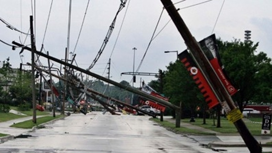 June 22: A row of electric power poles snapped along Floyd Street at Central Avenue in front of Cardinal Stadium at the University of Louisville in Louisville, Ky., after an apparent tornado moved through the area. At least five barns were damaged and horses were running loose Wednesday at Churchill Downs, home of the Kentucky Derby, after a powerful storm that spawned tornadoes blew through Louisville.
