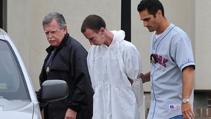 June 22: David Laffer, a suspect in the shooting deaths of four people at a pharmacy during a botched weekend painkiller robbery, is escorted out of Suffolk County Police Headquarters in Yaphank, N.Y.