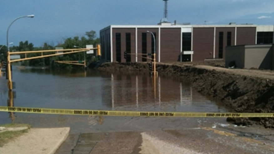 June 25: Flooding near City Hall in Minot, N.D.