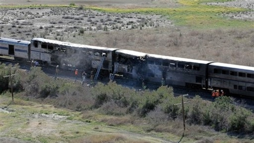 June 24. The wreckage from the collision between a semitrailer and a passenger Amtrak train in Nevada. Two people died and another 20 injured in the fiery blaze.