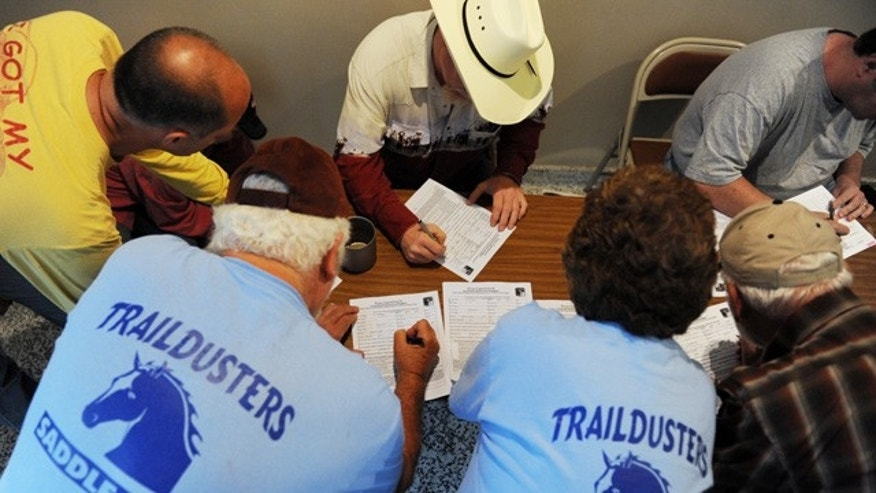 June 14: Volunteers with area horse clubs sign in at the Lauren Spierer search headquarters at McNutt Quad, on the campus of Indiana University, for an early morning search for Indiana University student Lauren Spierer.