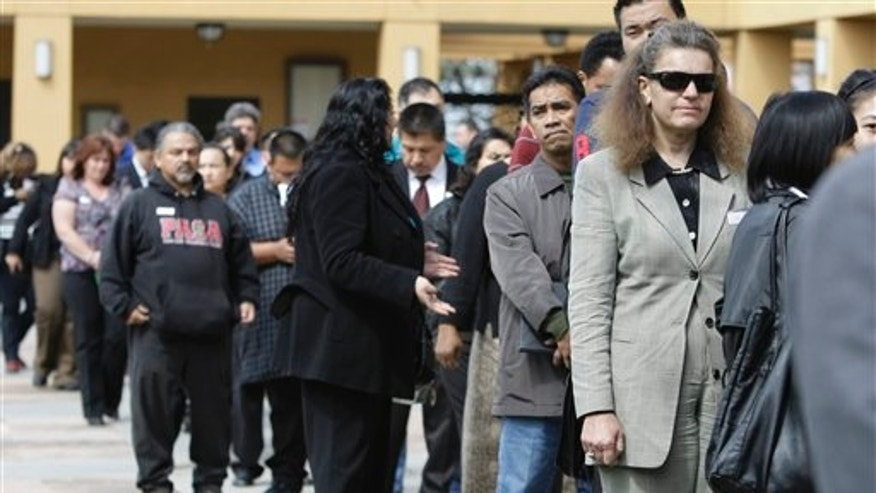 Job applicants wait in line at a job fair in San Jose, California.