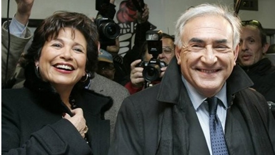 File Photo 2006: Dominique Strauss-Khan and his wife Anne Sinclair outside Paris.