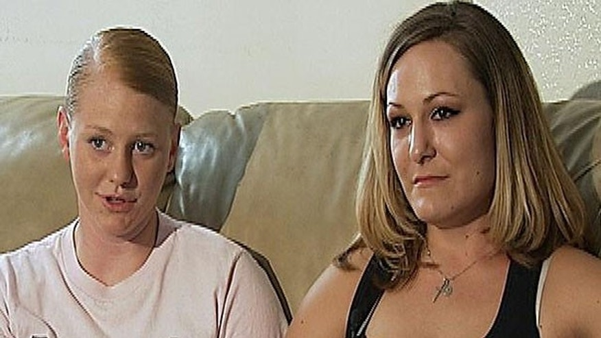 This undated image from video provided by KGTV shows U.S. Marine Cpl. Ashley Vice, left, and Jaime Murphy during an interview near Camp Pendleton, Calif. The same-sex couple are due to face charges of defrauding the government stemming from a sham marriage with a straight male Marine in order to receive an allowance for off-base housing.