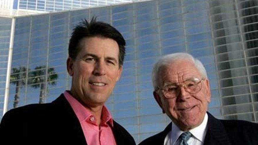 FILE: Robert A. Schuller, left, poses for a photo with his father, Robert H. Schuller, outside the Crystal Cathedral.