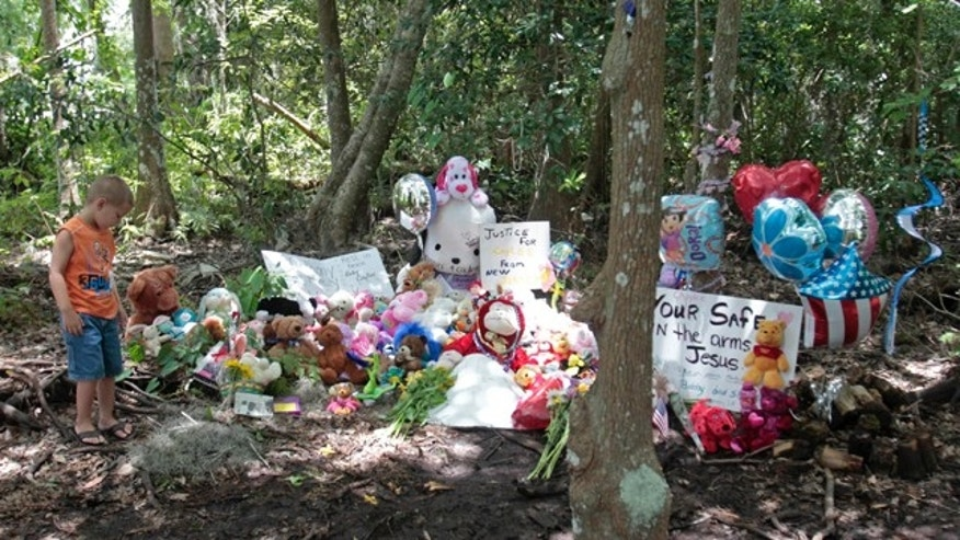 July5: Mark Likins, of Thomasville, Ga., visits the memorial of Caylee Anthony before Casey Anthony was found not guilty of first-degree murder, aggravated manslaughter and aggravated child abuse in Orlando, Fla.