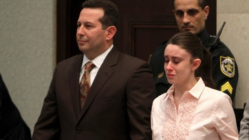 July 5: Casey Anthony holds hands with her defense attorney Jose Baez as they listen to the verdict at the Orange County Courthouse.