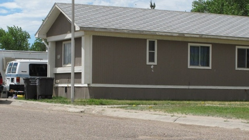July 8: A residence in Wheatland, Wyo., is shown where police say a man shot and killed four relatives in the house Thursday evening.