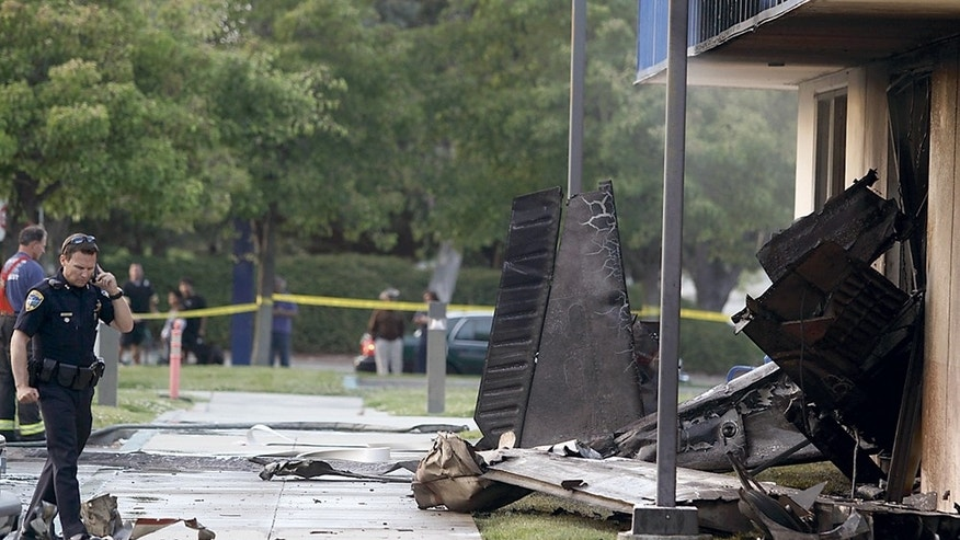 July 7: The wreckage of a small plane sticks out of the side of an unoccupied office building at Watsonville Community Hospital in Watsonville, Calif. The plane had just taken off from the Watsonville Municipal Airport. Two people were killed in the crash.