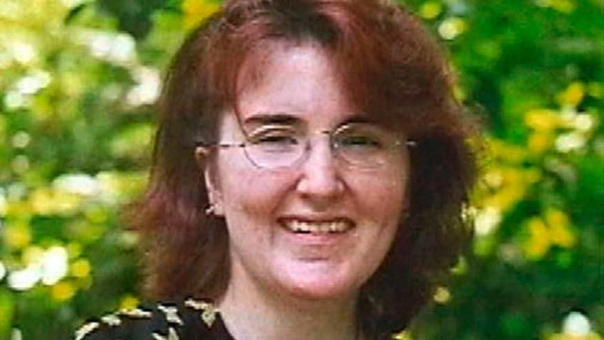 This undated family handout file photo shows missing woman, Joey Lynn Offutt, who is now 37, who has been missing since her infant son was found in her burned home on July 12, 2007 in Sykesville, Pa. Her family is offering a $25,000 reward for information on her whereabouts.