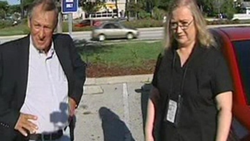 Tim Miller from Texas Equusearch, left, with Bonnie Moore from Process Express outside the Orange County jail Wednesday morning after serving Casey Anthony with a lawsuit.