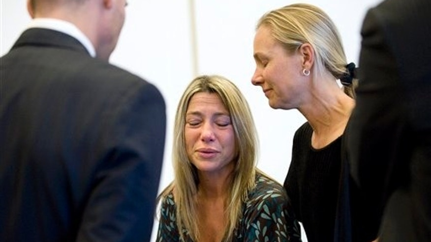 July 14: Kim Bayless, daughter of murder victim William McLaughlin, at right, consoles defendant Eric Naposki's fiancee, Rosie Macaluso, following a guilty verdict at Orange County Superior Court in Santa Ana, CA.