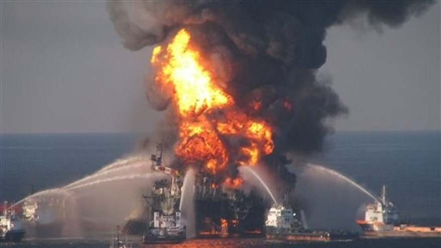 In this April 21, 2010 file image provided by the U.S. Coast Guard, fire boat response crews battle the blazing remnants of the off shore oil rig Deepwater Horizon.