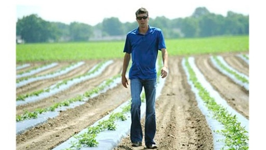June 2011: Braden Janowski walks through a watermelon field in Niles, Michigan.
