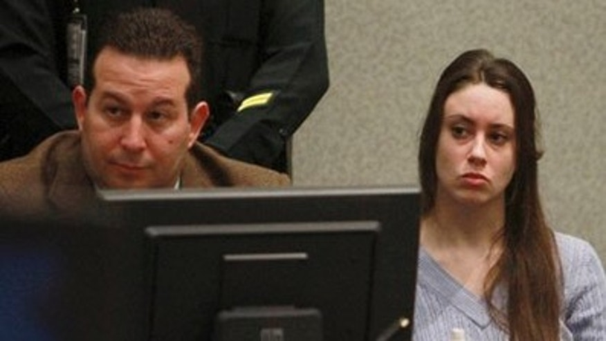 July 7: Casey Anthony and her attorney, Jose Baez, listen to arguments during her sentencing hearing in Orlando, Fla.